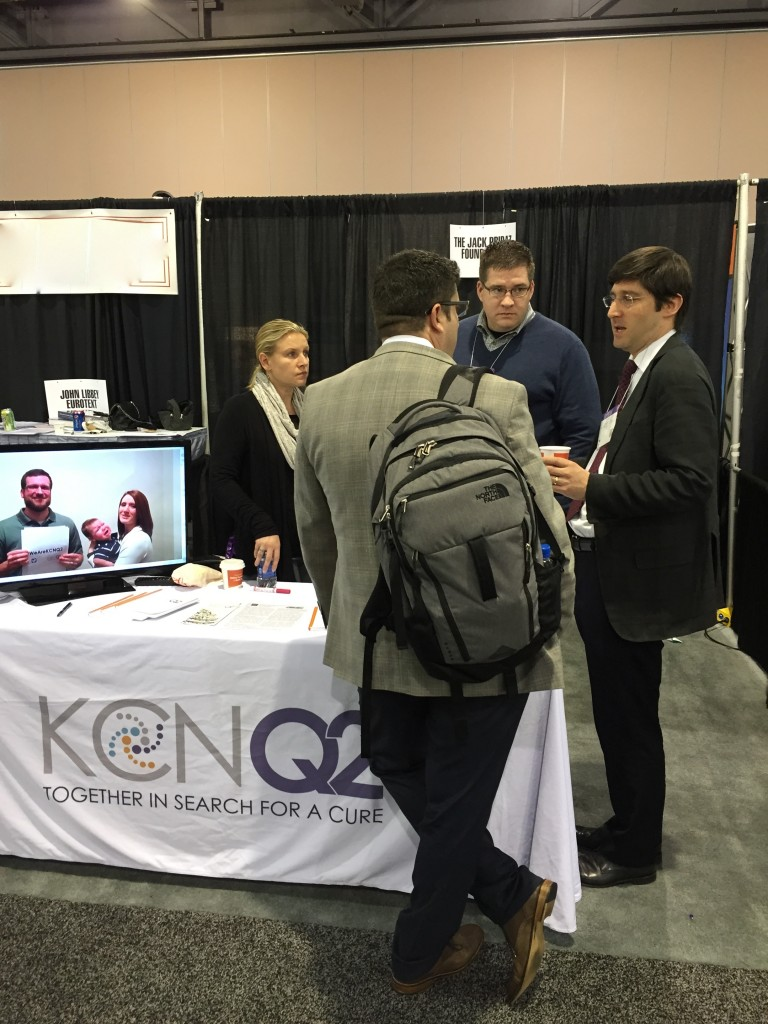 JPF booth at AES in Philadelphia. KCNQ2 famlies sent in #WeAreKCNQ2 videos to demonstrate their spirit and unity to the research community. Pictured: Liz Pribaz, Jim Thompson, Dr. John Millichap. View the #WeAreKCNQ2 video on our YouTube channel.